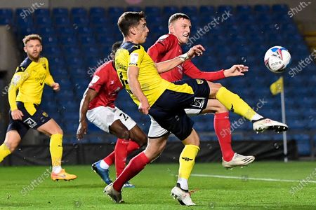 Oxford United midfielder Alex Rodriguez Gorrin(6) gets a shot away under pressure from Crewe Alexandra midfielder Oliver Finney (14) during the EFL Sky Bet League 1 match between Oxford United and Crewe Alexandra at the Kassam Stadium, Oxford