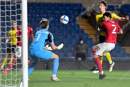 Oxford United midfielder Alex Rodriguez Gorrin(6) heads the ball  at goal under pressure from Crewe Alexandra defender Perry Ng (2) during the EFL Sky Bet League 1 match between Oxford United and Crewe Alexandra at the Kassam Stadium, Oxford