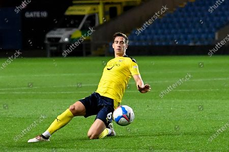 Oxford United midfielder Alex Rodriguez Gorrin(6) slides in to stop a loose ball during the EFL Sky Bet League 1 match between Oxford United and Crewe Alexandra at the Kassam Stadium, Oxford