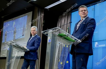 European Commission Vice President Maros Sefcovic, right, and European Commissioner for Justice Didier Reynders speak during a news conference following a video European Affairs Ministers meeting at the European Council headquarters in Brussels, . With the European Union on the verge of an embarrassing crisis, EU officials and a large majority of member states urged Poland and Hungary on Tuesday to lift their veto on the adoption of huge money package that threatens to derail the bloc's efforts to recover from the coronavirus pandemic