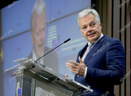 European Commissioner for Justice Didier Reynders speaks during a news conference following a video European Affairs Ministers meeting at the European Council headquarters in Brussels, . With the European Union on the verge of an embarrassing crisis, EU officials and a large majority of member states urged Poland and Hungary on Tuesday to lift their veto on the adoption of huge money package that threatens to derail the bloc's efforts to recover from the coronavirus pandemic