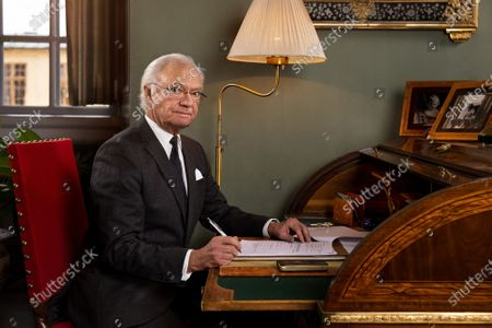 Sweden's King Carl Gustaf at his desk in the Stone Hall of Drottningholm Palace