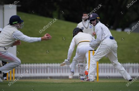 Martin Guptill tries to catch Peter Younghusband behind during day three of the Plunket Shield match between the Wellington Firebirds and Auckland Aces at the Basin Reserve in Wellington, New Zealand
