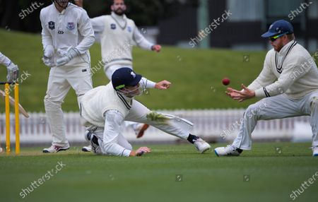 Martin Guptill and Glenn Phillips (right) try to catch Peter Younghusband behind during day three of the Plunket Shield match between the Wellington Firebirds and Auckland Aces at the Basin Reserve in Wellington, New Zealand
