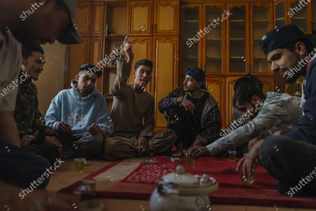 Jawad Sezdah, from left, Hadi Hashemi, Soaban Fareed, SeraJ AaToon AaToor, Qais Khaksar, Tamim Mats and other fellow rappers at their practice their free styling lyrics at their music studio OLBR recordO in the Pul-e-Surkhta neighborhood of Kabul, Afghanistan, on Saturday Oct. 24, 2020. Jawad Sezdah and his friends are artists who raps AfghanistanOs darkening future. Most days they sit around a circle at their Oclub,O a second-floor makeshift studio with a picture of Tupac Shakur is taped on the wall, in west KabulOs Pul-e-Surkhta neighborhood. They smoke weed, drink tea, and practice freestyle lyrics and breakdance together. (Marcus Yam / Los Angeles Times)