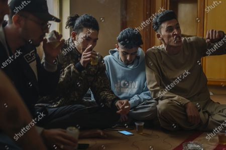 Sajad Temurian, from left, Jawad Sezdah, Hadi Hashemi, and Soaban Fareed, practice their free styling lyrics at their music studio OLBR recordO in the Pul-e-Surkhta neighborhood of Kabul, Afghanistan, on Saturday Oct. 24, 2020. Jawad Sezdah and his friends are artists who raps AfghanistanOs darkening future. Most days they sit around a circle at their Oclub,O a second-floor makeshift studio with a picture of Tupac Shakur is taped on the wall, in west KabulOs Pul-e-Surkhta neighborhood. They smoke weed, drink tea, and practice freestyle lyrics and breakdance together. (Marcus Yam / Los Angeles Times)