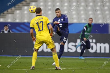 France's Kylian Mbappe passes the ball over Sweden's Viktor Claesson during the UEFA Nations League soccer match between France and Sweden at the Stade de France stadium in Saint-Denis, northern Paris