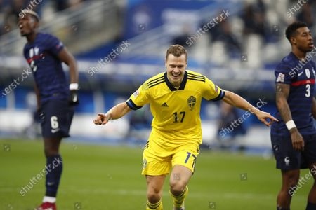 Sweden's Viktor Claesson celebrates after scoring the opening goal of his team during the UEFA Nations League soccer match between France and Sweden at the Stade de France stadium in Saint-Denis, northern Paris