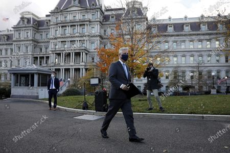 National security adviser Robert O'Brien walks to talk to reporters outside the West Wing of the White House in Washington, DC, USA, on 17 November 2020