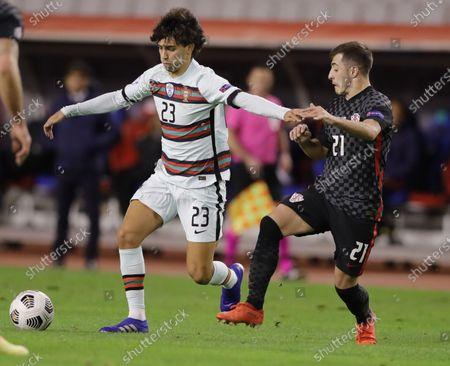 Croatia's Domagoj Vida (R) in action against Joao Felix of Portugal during the UEFA Nations League, League A, group 3 soccer match, between Croatia and Portugal in Split, Croatia, 17 November 2020.