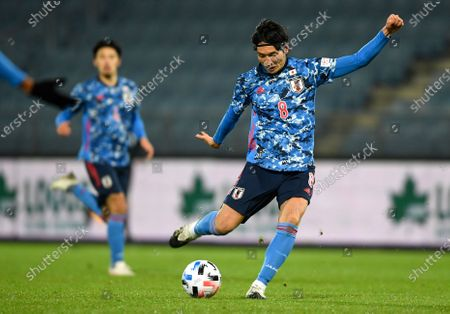 Genki Haraguchi takes a shot at goal during the international friendly soccer match between Japan and Mexico at the Liebenauer Stadium in Graz, Austria