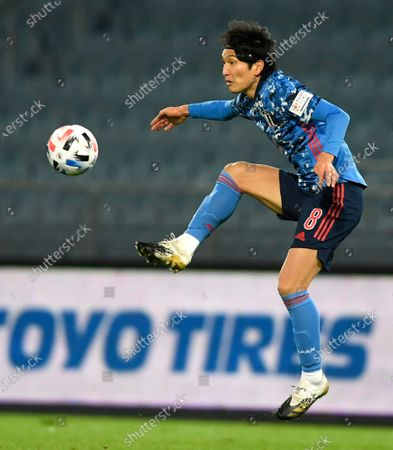 Genki Haraguchi attempts to control the ball during the international friendly soccer match between Japan and Mexico at the Liebenauer Stadium in Graz, Austria