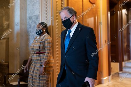 Sen. Doug Jones, D-Ala., who lost his re-election race, leaves the chamber after the Senate failed to confirm President Donald Trump's controversial nominee to the Federal Reserve, Judy Shelton, at the Capitol in Washington