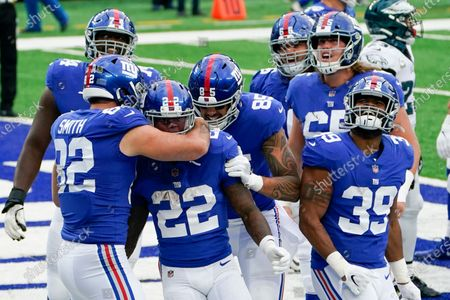 New York Giants running back Wayne Gallman (22) is congratulated by the team after his touchdown in the second half of an NFL football game against the Philadelphia Eagles, in East Rutherford, N.J