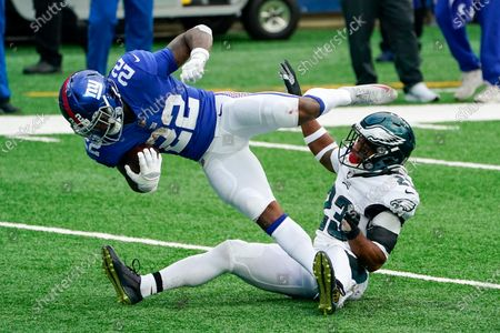 Philadelphia Eagles free safety Rodney McLeod (23) brings down New York Giants running back Wayne Gallman (22) in the second half of an NFL football game, in East Rutherford, N.J