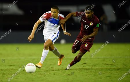 Chile's Alexis Sanchez, left, and Venezuela's Cristian Casseres battle for the ball during a qualifying soccer match for the FIFA World Cup Qatar 2022 in Caracas, Venezuela