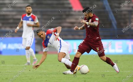 Chile's Alexis Sanchez, left, and Venezuela's Junior Moreno battle for the ball during a qualifying soccer match for the FIFA World Cup Qatar 2022 in Caracas, Venezuela