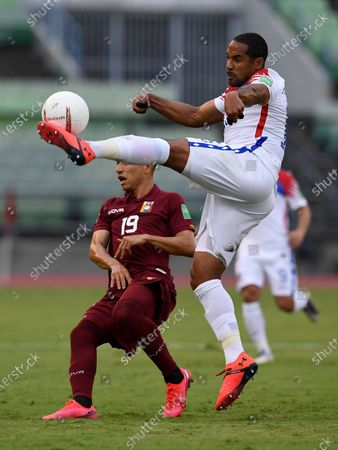 Stock Photo of Chile's Jean Beausejour, right, and Venezuela's Jefferson Savarino battle for the ball during a qualifying soccer match for the FIFA World Cup Qatar 2022 in Caracas, Venezuela