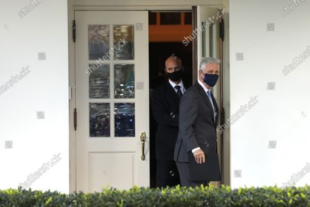 National security adviser Robert O'Brien walks out to talk to reporters outside the West Wing of the White House in Washington.