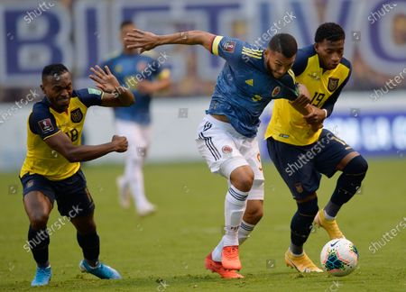 Colombia's Luis Suarez, center, fights for the ball with Ecuador's Pedro Perlaza, left, and Gonzalo Plata during a qualifying soccer match for the FIFA World Cup Qatar 2022 in Quito, Ecuador