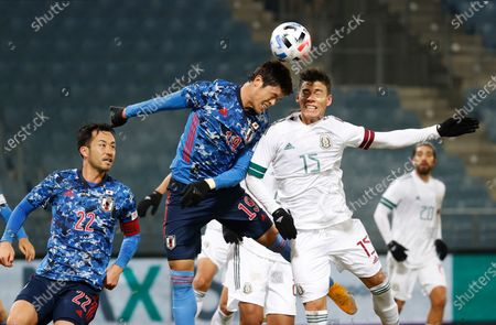 Stock Image of (L-R) Maya Yoshida of Japan, Hiroki Sakai of Japan and Hector Moreno of Mexico in action