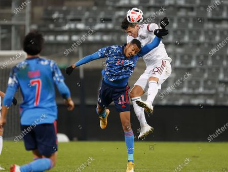 Musashi Suzuki (C) of Japan and Hector Moreno (R) of Mexico in action