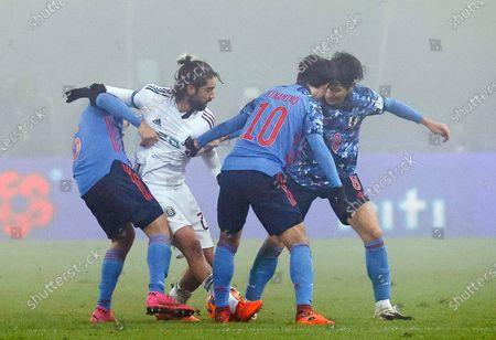 (L-R) Wataru Endo of Japan, Rodolfo Pizarro of Mexico, Takumi Minamino of Japan and Genki Haraguchi of Japan in action during the international friendly soccer match between Japan and Mexico in Graz, Austria, 17 November 2020.