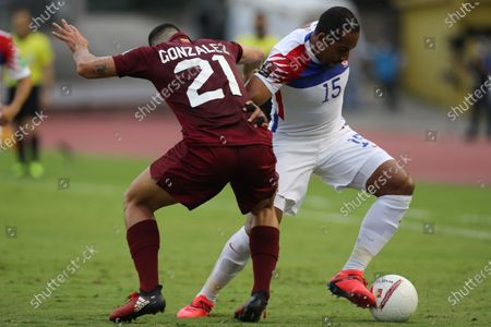 Stock Picture of Venezuela's Alexander Gonzalez (L) in action against Chile's Jean Beausejour during a match for the South American Qualifiers for the Qatar 2022 World Cup, at the Olympic Stadium in Caracas, Venezuela, 17 November 2020.