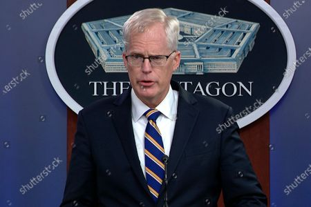 In this, image taken from a video provided by Defense.gov Acting Defense Secretary Christopher Miller speaks at the Pentagon in Washington. Miller said Tuesday that the U.S. will reduce troop levels in Iraq and Afghanistan by mid-January, asserting that the decision fulfills President Donald Trump's pledge to bring forces home from America's long wars even as Republicans and U.S. allies warn of the dangers of withdrawing before conditions are right