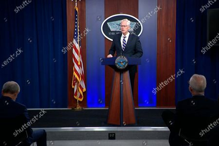 In this, image taken from a video provided by Defense.gov, Acting Defense Secretary Christopher Miller speaks at the Pentagon in Washington. Miller said Tuesday that the U.S. will reduce troop levels in Iraq and Afghanistan by mid-January, asserting that the decision fulfills President Donald Trump's pledge to bring forces home from America's long wars even as Republicans and U.S. allies warn of the dangers of withdrawing before conditions are right