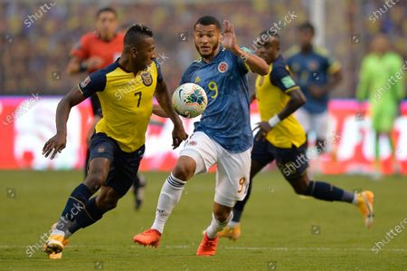 Ecuador's Pervis Estupinan, left, battles for the ball with Colombia's Luis Suarez during a qualifying soccer match for the FIFA World Cup Qatar 2022 in Quito, Ecuador