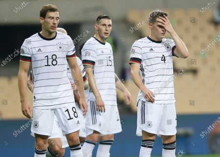 Germany's Leon Goretzka, Niklas Suele and Matthias Ginter, from left, react following the UEFA Nations League soccer match between Spain and Germany in Seville, Spain, . Spain won the match 6-0
