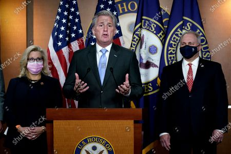 House Minority Leader Kevin McCarthy, R-Calif., center, flanked by GOP Conference chair Rep. Liz Cheney, R-Wyo., left, and House Minority Whip Steve Scalise, R-La., right, speaks to reporters following their leadership elections for the 117th Congress, at the Capitol in Washington