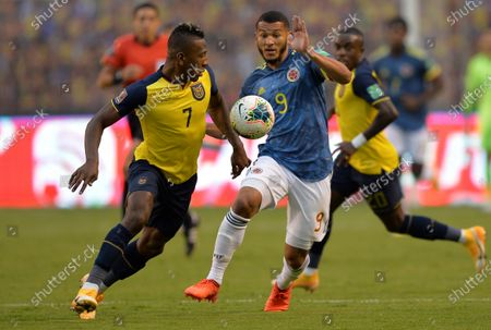 Pervis Estupinan (L) of Ecuador vies for the ball with Luis Suarez of Colombia during South American qualifiers to Qatar 2022 World Cup between national soccer teams of Ecuador and Colombia at LDU stadium in Quito, Ecuador, 17 November 2020.