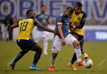 Pedro Perlaza (L) and Gonzalo Plata (R) of Ecuador vie for the ball with Luis Suarez of Colombia during South American qualifiers to Qatar 2022 World Cup between national soccer teams of Ecuador and Colombia at LDU stadium in Quito, Ecuador, 17 November 2020.