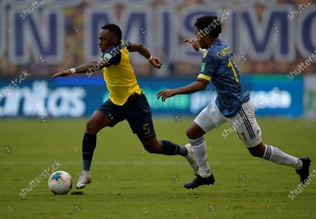 Renato Ibarra (L) of Ecuador vies for the ball with Juan Cuadrado of Colombia during South American qualifiers to Qatar 2022 World Cup between national soccer teams of Ecuador and Colombia at LDU stadium in Quito, Ecuador, 17 November 2020.