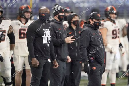 Stock Picture of Oregon State head coach Jonathan Smith, right, on the sldeline during an NCAA college football game against Washington, in Seattle