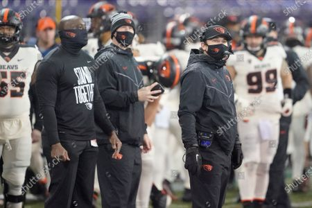 Stock Photo of Oregon State head coach Jonathan Smith, right, on the sldeline during an NCAA college football game against Washington, in Seattle
