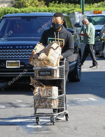 John Legend is seen food shopping at Bristol Farms