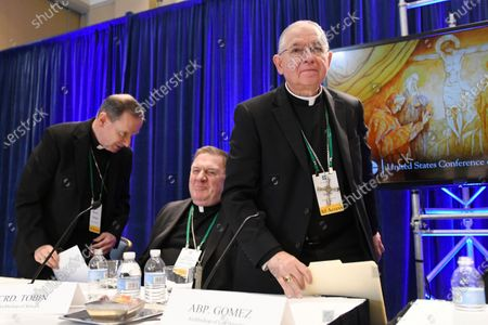 """Archbishop Jose H. Gomez, right, of Los Angeles, with Bishop Michael F. Burbidge, left, of Arlington, Va., and Cardinal Joseph William Tobin, of Newark, N.J., exits a news conference after being elected president of the United States Conference of Catholic Bishops during their Fall General Assembly in Baltimore. On Tuesday, Nov. 17, 2020, Gomez addressed an online national meeting of bishops. During the previous week, Gomez congratulated Joe Biden on his presidential election victory. Now, Gomez is sounding a different tone, saying some of Biden's policy positions, including support for abortion rights, pose a """"difficult and complex situation"""" for the church"""