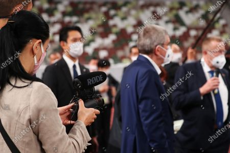 Stock Image of (L-R) Naomi Kawase,  IOC President Thomas Bach, John Coates : IOC President Thomas Bach visits the National Stadium (Olympic Stadium) for the Tokyo 2020 Olympic Games in Tokyo, Japan.