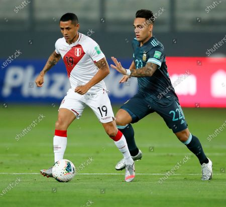 Argentina's Lautaro Martinez, right, and Peru's Yoshimar Yotun battle for the ball during a qualifying soccer match for the FIFA World Cup Qatar 2022, in Lima, Peru