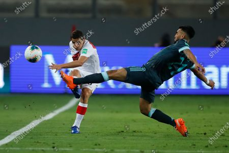 Argentina's Nicolás González, right, and Peru's Aldo Corzo battle for the ball during a qualifying soccer match for the FIFA World Cup Qatar 2022 in Lima, Peru