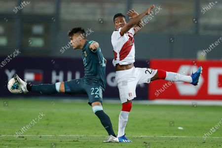 Peru's Pedro Aquino, right, and Argentina's Lautaro Martinez battle for the ball during a qualifying soccer match for the FIFA World Cup Qatar 2022 in Lima, Peru