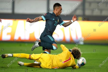 Argentina's Lautaro Martinez, center, controls the ball past Peru's goalkeeper Pedro Gallese to score his side's second goal during a qualifying soccer match for the FIFA World Cup Qatar 2022 in Lima, Peru