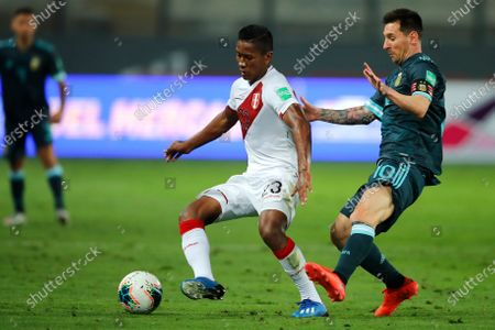 Argentina's Lionel Messi, right, and Peru's Pedro Aquino battle for the ball during a qualifying soccer match for the FIFA World Cup Qatar 2022 in Lima, Peru