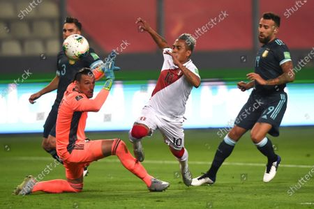 Peru's Christian Cueva, center, and Argentina's goalkeeper Franco Armani, left, battle for the ball during a qualifying soccer match for the FIFA World Cup Qatar 2022 in Lima, Peru