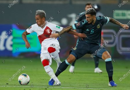 Peru's Christian Cueva (L) in action against Argentina's Leandro Paredes (R) during a match for the South American Qualifiers for the Qatar 2022 World Cup at the National Stadium in Lima, Peru, 17 November 2020.