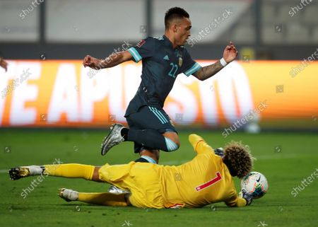 Argentina's Lautaro Martinez dribbles past goalkeeper of Peru, Pedro Gallese, to score during a match for the South American Qualifiers for the Qatar 2022 World Cup at the National Stadium in Lima, Peru, 17 November 2020.