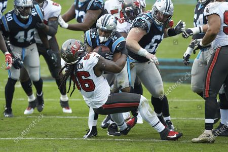 Carolina Panthers running back Rodney Smith (35) is tackled by Tampa Bay Buccaneers defensive tackle Steve McLendon (96) during an NFL football game, in Charlotte, N.C